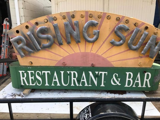 The Rising Sun Restaurant and Bar's sign. The sign