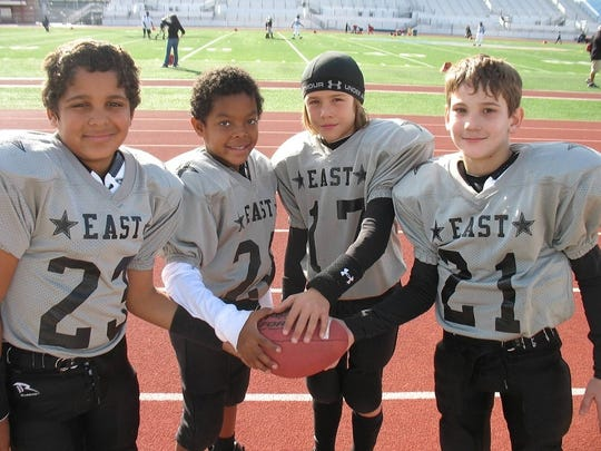 Marques Prior (far left) and JD Lang (third from left) met in kindergarten and since have forged a friendship through football.