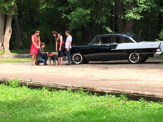 Behind the scenes at a charity calendar shoot at Sheboygan's Evergreen Park on Aug. 5.