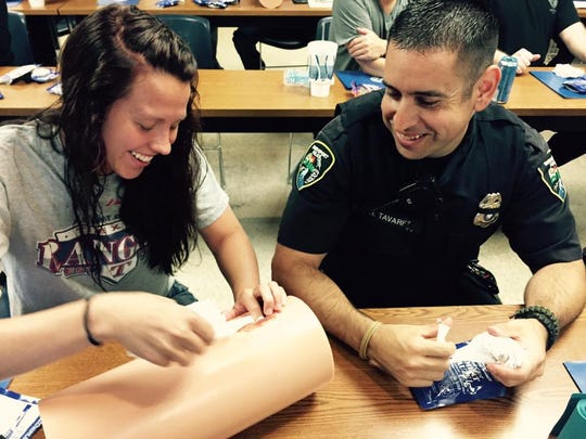 Officers participating in a First Chance trauma kit training.