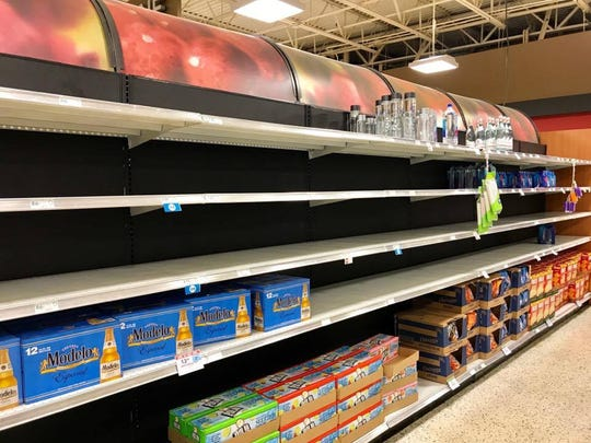 Publix on North Collier Boulevard on Marco Island was almost out of water by Wednesday afternoon as residents rushed to stock up before Hurricane Irma. Stores began running out of supplies as early as Monday.
