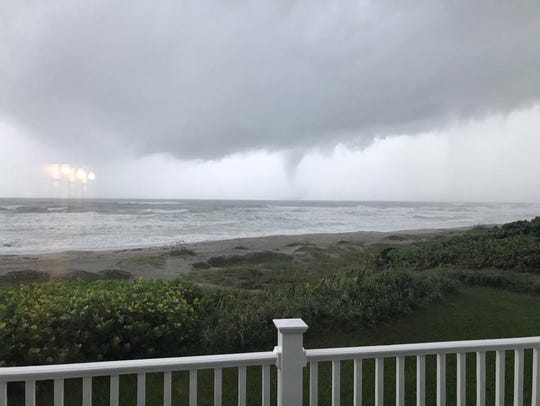 An apparent tornado off the coast of Indialantic.