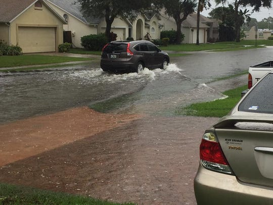 Street flooding in Pelican Harbour subdivision off