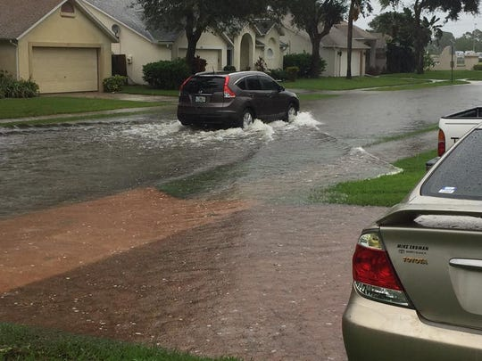 Street flooding in Pelican Harbour subdivision off Murrell Road in Rockledge.