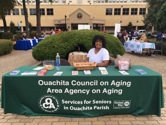 Loretta Hudson mans the information booth during a