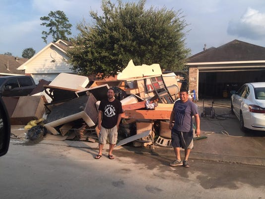 636410287598182661-Clean-up-after-Huricane-Harvey.jpg