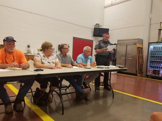 Dagsboro Police Chief Floyd Toomey presents on a proposal that would unify the Dagsboro and Frankford police departments at the Dagsboro fire hall on Sept. 13, 2017.