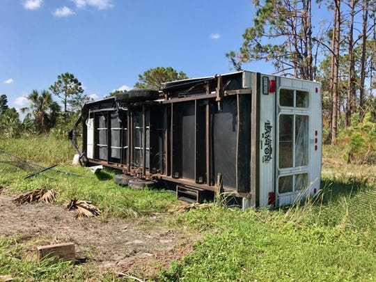 An RV tipped over by Hurricane Irma's 130 mph winds rests in Daphne Mitchelson's backyard on Sept. 20, 2017. Mitchelson said she tried to convince her friend, who owns the RV, to bolt it down before the storm.