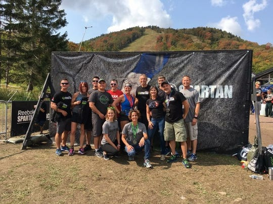 A group of locals pose for a photo at the Spartan Ultra Beast race in Killington, Vt. on Sept. 16.