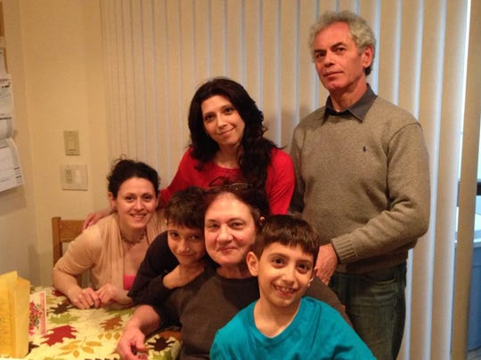 Vittoria Valentin, at left in the back row, stands beside her father, Bruno Cosentino, who has Alzheimer's disease. From left in the front row are her sister, Gabriella Cosentino, son Joseph Valentin, her mother Mirella Cosentino and son Cristofer Valentin.
