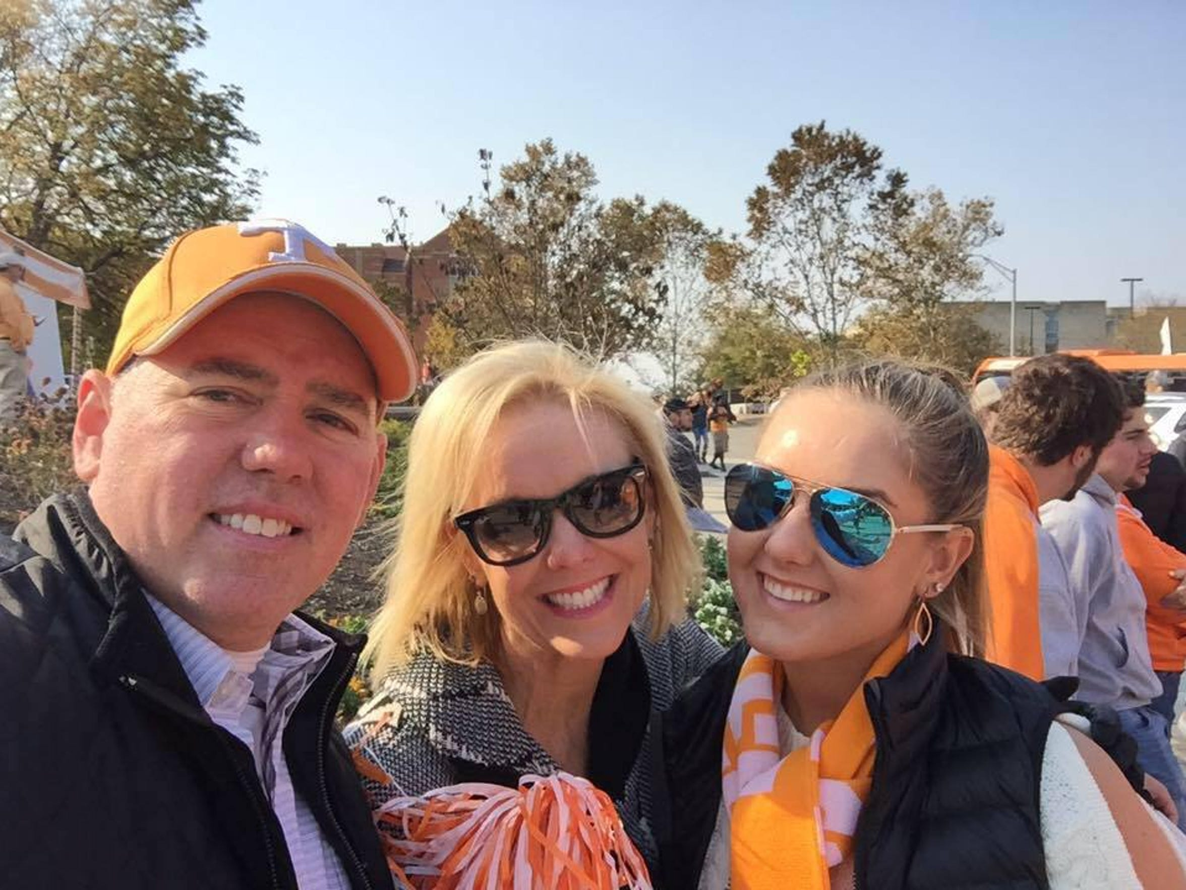 Mark (left), Yvette (middle) and Hadley (right) Walts are all supporters of the University of Tennesse.