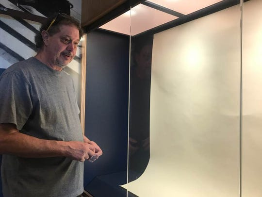 Bruce Ranier, an outside contractor, sets the displays