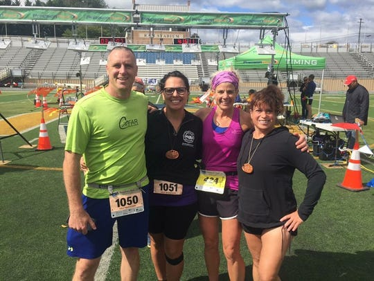 Waynesboro CFAR runners JR Bowers, Steph Bowers, Rheeana