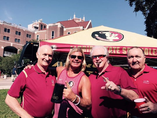 Matt Pave, second from left, hasn't missed an FSU game, home or away, since 1995. He's pictured here with, left to right, Dr. Dano Fiore, Barry Smith and Gary Huff.