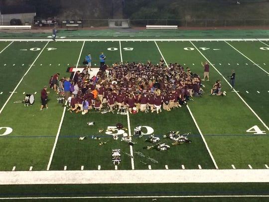 John Glenn students gather in prayer for Tyler Herron.
