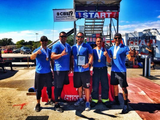 Pictured are Todd Vannatter, Richard Ramirez, Mark Johnson Casey Collins and Geronimo Ontiveros. The Carlsbad Fire Combat Challenge Team won first place in the Scott Firefighter Combat Challenge relay competition Oct. 7 in Tyler, Texas.