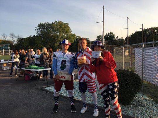 Greendale High School students collect donations for the JJ Watt Foundation at the school's football game against Peawaukee.
