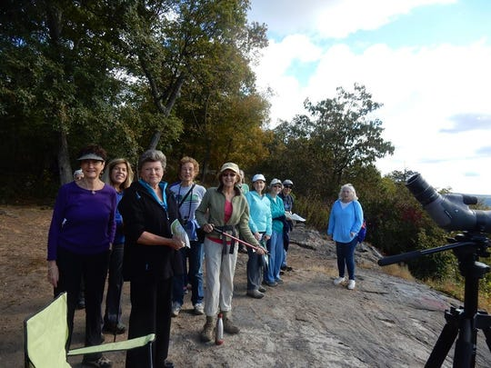 In celebration of National Public Lands Day, the Land Conservancy of New Jersey sponsored a Hike to the Hawkwatch in Rockaway Twp.     Pictured are ladies from the GFWC Woman's Club of the Denville-Rockaway area, who hiked to the ledge to observe the migrating birds. Volunteer Hawkwatcher, Mike who is one of many volunteers that spends hours at a time counting the variety of birds that travel past this location, gave a wonderful presentation regarding the yearly migration and explained how thousands of birds can pass this way in the spring and again in the fall.  The Land Conservancy of New Jersey, among other partners has helped preserve hundreds of acres around this location.