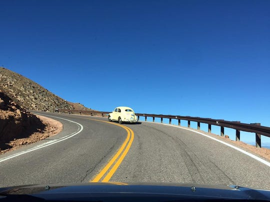 Ascending Pike's Peak at 10 miles per hour in a 36-horsepower