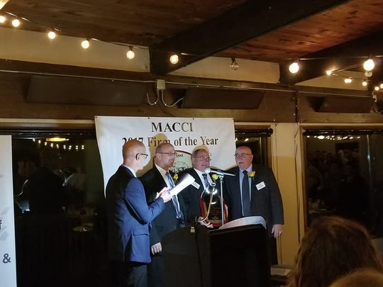 The Heiman brothers were honored Thursday night at RiverEdge Golf Course as Nasonville Dairy was named Marshfield's Firm of the Year.