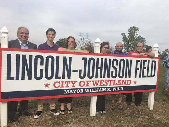 Members of the late Rose Johnson's family posed with the new sign dedicating Lincoln-Johnson Field in Norwayne.