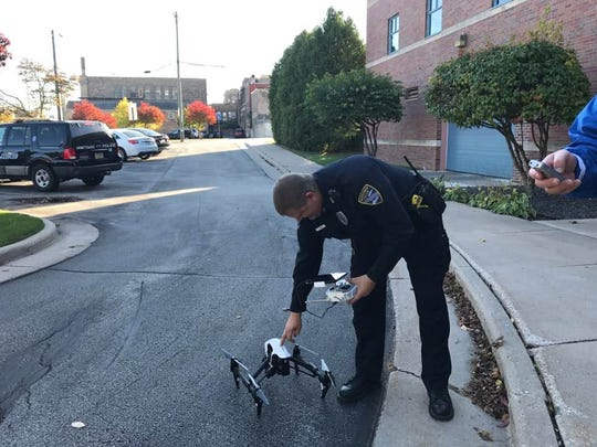 Officer Rick Ladwig sets up the drone for a demonstration outside the Public Safety Building Oct. 17, 2017.