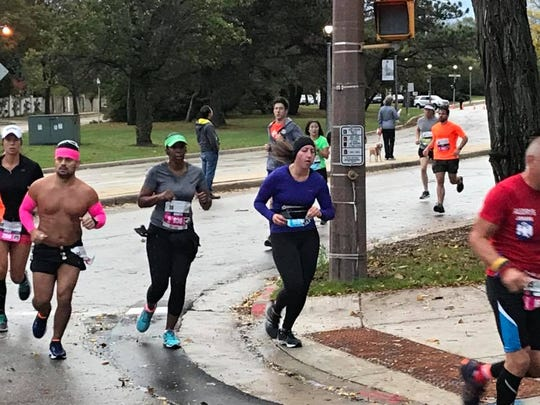 Ronetta Watson (center) had the company of running partner Avelino 'Lino' Jimenez (left), who coached her through the race.