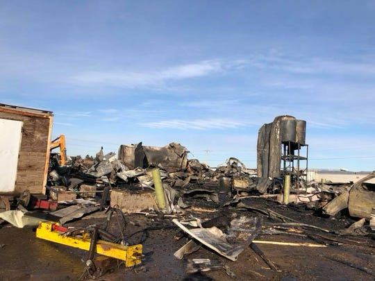 The aftermath of a fire and total loss of a machine shed at Bach Farms in Dorchester.