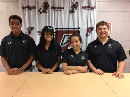 Students of Menomonee Falls High School's business academy pose for a picture behind the Falls Gear Store counter.