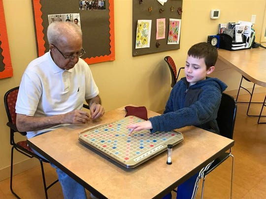 Charles E. Gaines, left, and Jarret Chickering, 10, play Scrabble at the Montclair YMCA Park Street branch on Nov. 9, 2017.