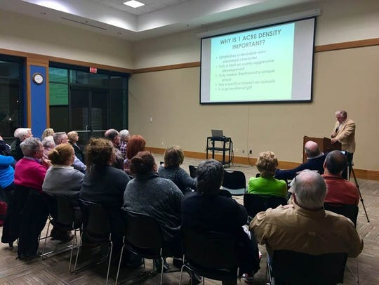 Residents listen to a presentation by Preserve Brentwood