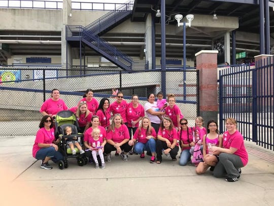 The Pink Warriors Team with family members at the 2017