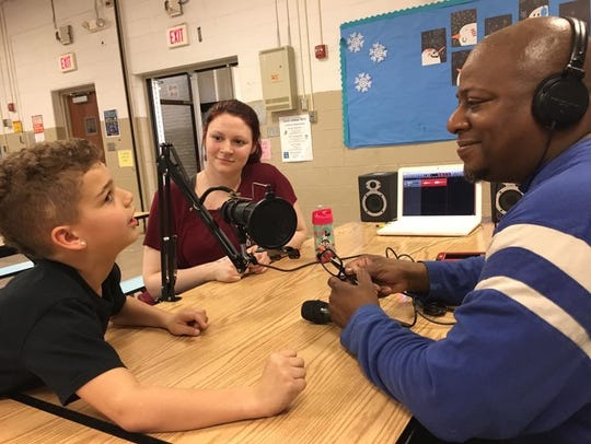 Terry Nelson, right, teaches local students the ins