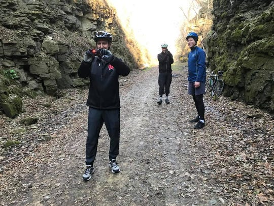 Bob Dohr, John McNeill and David Paulsen on the Badger State Trail. John's theory is that if a circle of people take photos of each other at the same moment, it will create a black hole. Didn't happen. We don't think.