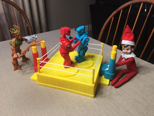 Elf on the Shelf playing Rock 'Em Sock 'Em Robots. They could really play any game you have lying around right?