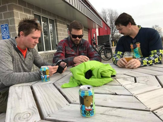 Adam Peterson, Ben Rennert and Kyle Shilts hang out at Bare Bones Brewery.