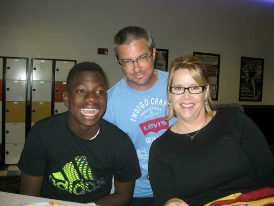 JaJuan Cherry (left) poses with his legal guardians, Dylan and Dana Tedders in Okeechobee.