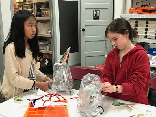 Students in the Montclair Learning Center STEM Center decorate robots they've built  for a competition being offered by littleBits, a startup company that makes electronic building blocks for building droids.