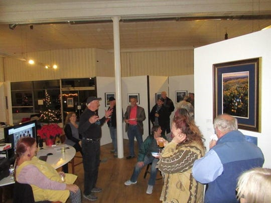 Malkerson Gallery 408 owner Warren Malkerson greets the crowd of approximately 50 local artists and enthusiasts at the Tularosa Basin Gallery.