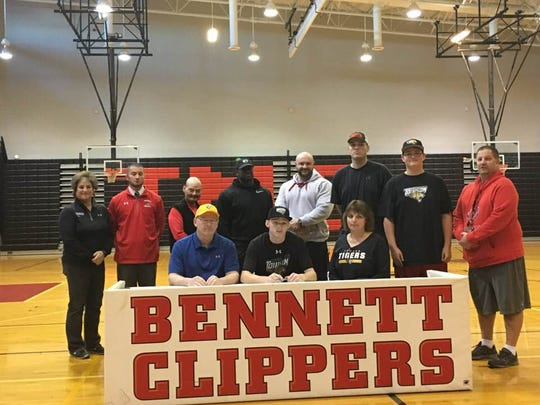 Dallas Repine signs his letter of intent to play baseball for Towson University.