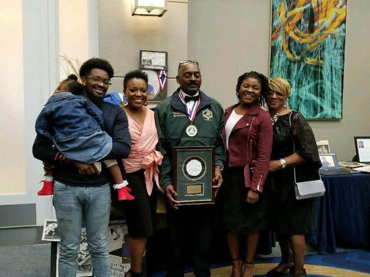 Alphonso Henry poses with his family at the National Wrestling Hall of Fame banquet.