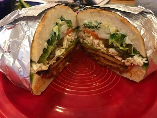 A marinated pork torta from Azteca Mexican Restaurant in Toms River,