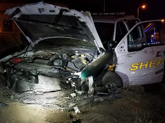 The front view of a stolen San Juan County Sheriff's Office patrol vehicle on Monday, Dec. 18, 2017 near the intersection of Bloomfield Highway and Resource Road in Farmington.  A 16-year-old female is accused of stealing and crashing the vehicle.