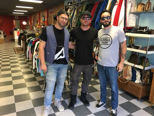 Spaceboy Clothing co-owner David Sanchez (right) and Wilmington's Brad Wallace (left) with actor and Delaware native Ryan Phillippe at the Market Street retail shop.