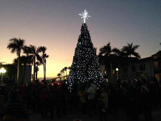 The sun sets at the end of the Christmas parade in