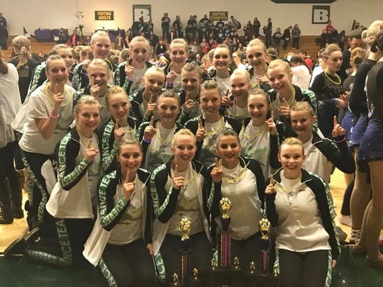 The D.C. Everest Varsity Dance Team celebrates success at the Ashwaubenon Dance Invite.