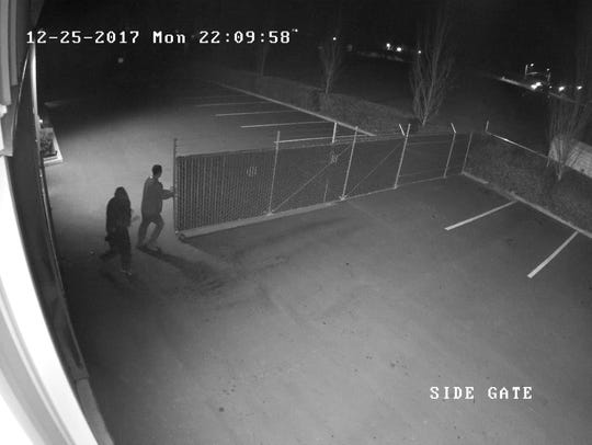 Surveillance footage shows two men apparently cutting