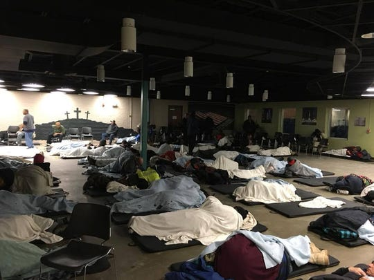 Wheeler Mission posted this photo on its Facebook page showing men sleeping on the floor during a bitterly cold night.