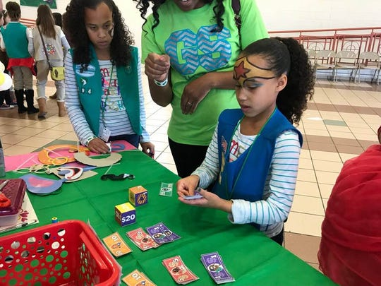Alicia Encinas practiced giving change at the Girl Scouts of the Desert Southwest's Cookie Rally Jan. 6.