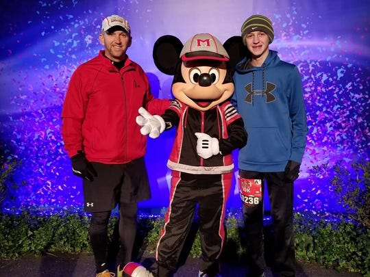 Greencastle's Todd Kirkwood, left, and Nathan Kirkwood, 13, pose for a photo before taking on a 10K race at last weekend's Walt Disney World Marathon Weekend.